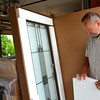 Fr. Bryon takes a look at the new window for the novitiate's front door