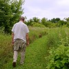 Fr. Byron takes Jarle for a walk on one of the trails that are on the novitiate property