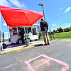 KRISTOPHER RADDER — BRATTLEBORO REFORMER<br /> Markings on the ground allow people to social distance while ordering food from the Tito's Taqueria, a food truck at the Black Mountain Square on Putney Road, in Brattleboro, on Tuesday, May 5, 2020.