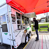 KRISTOPHER RADDER — BRATTLEBORO REFORMER<br /> Michael Fuller, of Brattleboro, Vt., orders food from Tito's Taqueria, a food truck at the Black Mountain Square on Putney Road, in Brattleboro, on Tuesday, May 5, 2020.