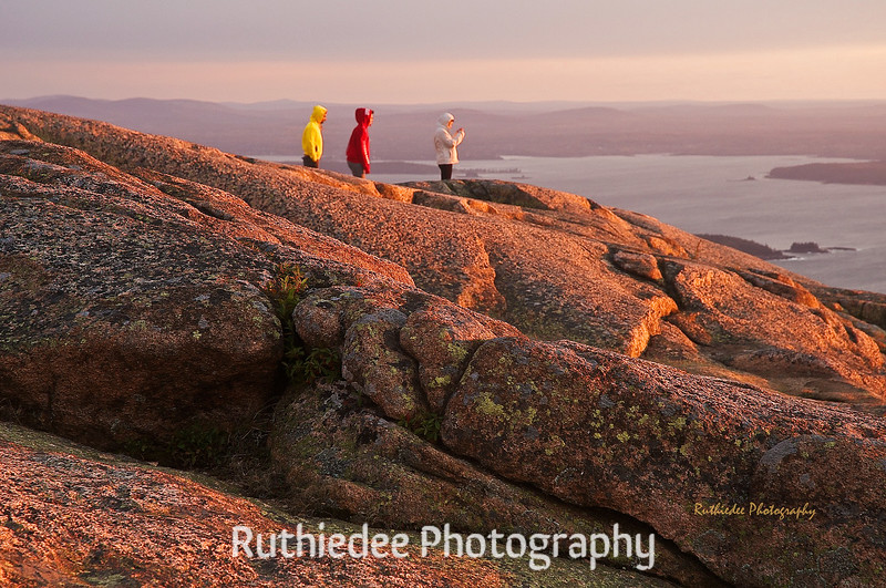 Greeting first sun on Cadilac Mountain in Acadia National Park, Maine...