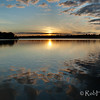 """Sunset at dock level on Black Lake near Perth, Ontario. <a href=""""http://www.gettyimages.ca/detail/photo/sunset-on-black-lake-near-perth-ontario-royalty-free-image/166549226"""" target=""""_blank"""">License this photo on Getty Images</a> © Rob Huntley"""