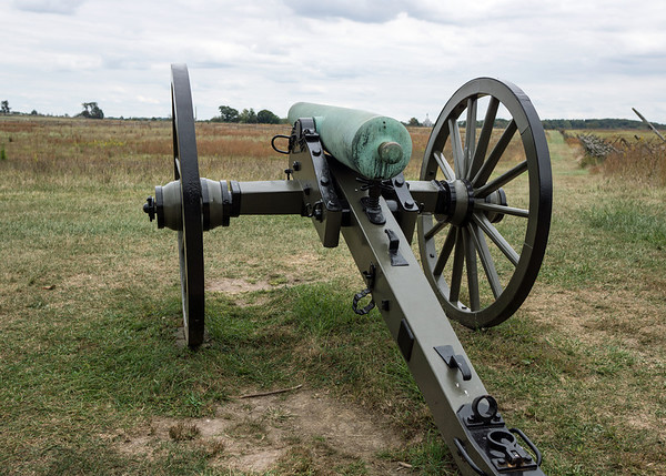 Patina: time has turned the bronze barrel of this Napoleon cannon green on the field at Gettysburg.  The trees in the distance are on Cemetery Ridge, which was held by Federal troops as Confederates attacked across the fields in Pickett's Charge on July 3, 1863.