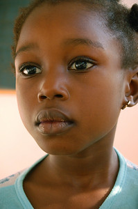 Beautiful little girl. Look at her eyes. Can you tell she isn't feeling well?