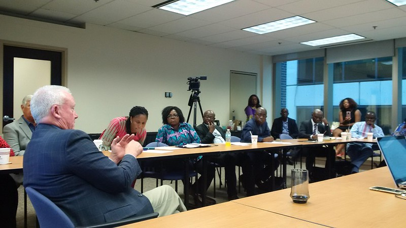 REALTOR® Mike Drews answers questions from members of the Ghana delegation.
