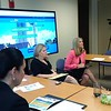 Tara Pavlik (second from left) and Debra Olsen (second from right) lead a breakout session about IHDA.