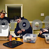 Members of the Midwest Ghost Society prepare equipment before their paranormal investigation of the Sandwich Opera House on Jan. 28. From left, Rachel Shuning of Earlville, Michelle Lemire of Plano, founder of MGS, and Ray Buchanan Jr. of Newark.