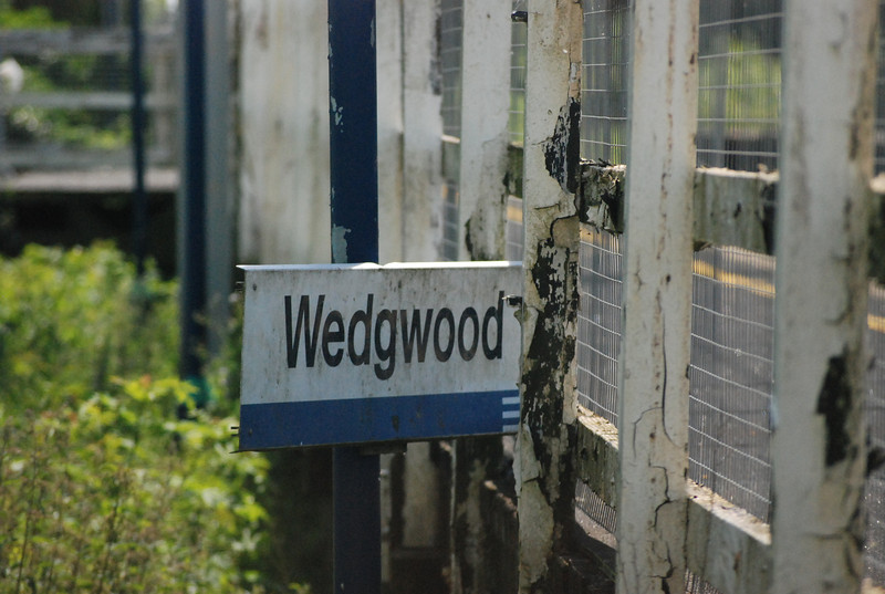 One of the Station signs on Plat 2 has been pulled down behind the fence taken with a 200mm lens on