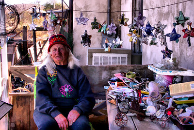 The Star Maker Jeannie of Randsburg CA. She collects pottery and glass from all over the ghost town and makes start out of them with twisted wire.