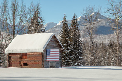 Barn in Swan Valley, backed by the Mission Mountains, Montana
