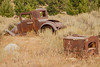 Old car and furnace at Elkhorn Ghost Town, Montana.