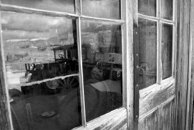 """Days gone by"" . Reflections of an old truck in the store window at Bodie. shot in B&W."