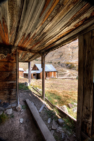 Animas Forks Ghost Town, Colorado. Located on the Alpine Loop, The town was established in  1873 and by 1876 grew to have 30 cabins, a hotel, a general store, a saloon, and a post office. By 1883 450 people lived in Animas Forks and in 1882 a newspaper, the Animas Forks Pioneer, began publication and lasted until October 1886. Every fall the residents moved to the town of Silverton, where it was warmer. In 1884 a 23 day blizzard inundated the town with 25 feet of snow and the residents had to dig tunnels to get from building to building.