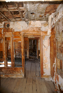 Interior view of miner's house.  The oil cloth is still attached to the walls in some places which was used to provide some insulation and decor.