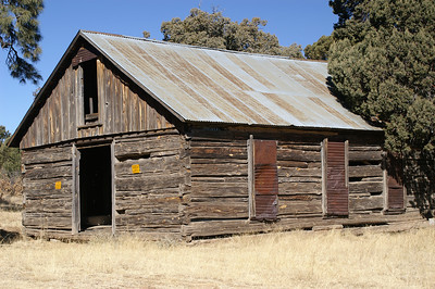 Log schoolhouse in Jicarilla, built in 1907.