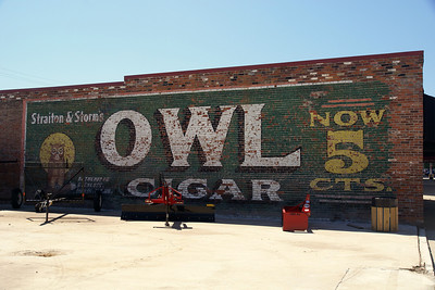 Wall-size ad for Owl Cigar Pleasanton, KS