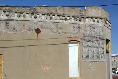 Someone has ben removing the plaster off this building, revealing a ghostsign underneath. Dennison, TX