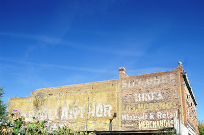 Wallful of ads in Las Vegas, NM