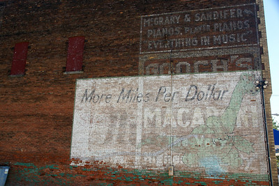 Three signs in one.  Sinclair Gasoline, Gooch's Macaroni, and McGrary & Sandifer Pianos.  Found in Brookfield, MO