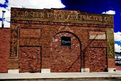 I had to Photoshop this one to get the lettering to stand out in order to read the signs. St Joseph Truck And Tractor Co. Wallis - Willy's St Joe, MO