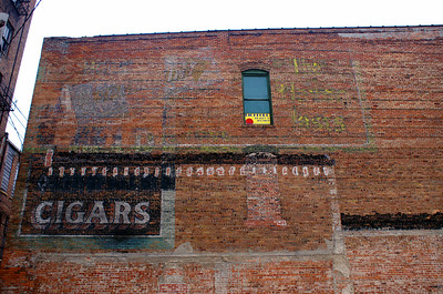 This wall appears to have had 2 ads at different points in time.  One for gum and another for cigars. Fort Dodge, IA.