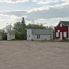 The Red building was a bar and the space next to it had a large building, a double lot size that had Greenshield's Drugstore in it when I was a kid.  It had the Original WE Adams Hardware as well. This town had two hardware stores and then in the 40's I believe were combined and then bought my Uncle the Great Nephew of the original Store owner W E Adams!  His store was called Ken Adams Hardware.