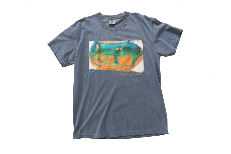 TEE - oval on blue jean<br /> Art printed on cotton fabric, hand sewn onto 100% cotton shirt<br /> Large