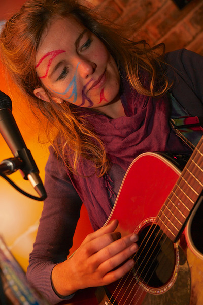"Lizzie Lou Gaisford playing the guitar for <a href = ""https://www.facebook.com/thefishwives"" target = ""_blank"">Fishwives</a>."