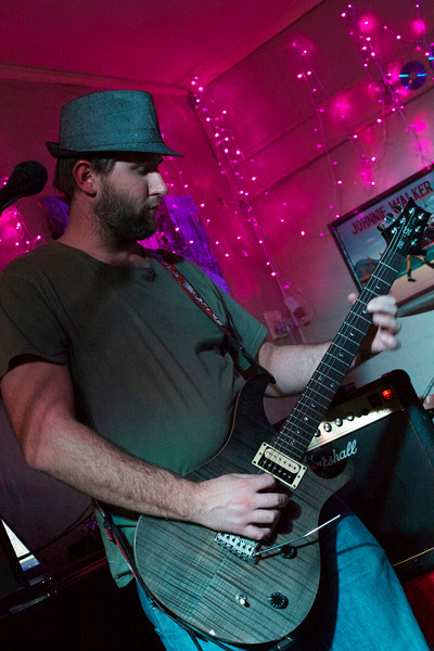 Luke Clayton on the guitar for Shackles & Bones