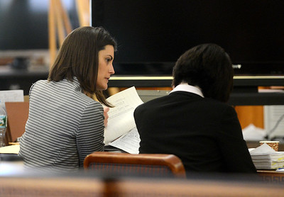 Tania Barricklo-Daily Freeman                       Orange County assistant district attornies Tanja Beemer, left,  Maryellen Albanese, right, talk over papers while  in court Thursday morning.