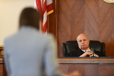 Tania Barricklo-Daily Freeman                      Uster County Judge Donald Williams listens on as Orange County assistant district attorney Tanja Beemer questions a witness.