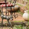 Ibis drinking from pond next to giraffe statue at Giraffe Manor