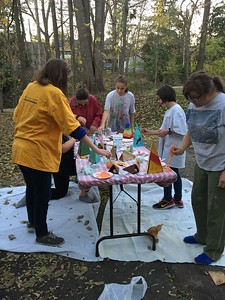 painting windchimes this fall out side our meeting place.  erica on the far right