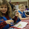 Tewksbury and Wilmington Girl Scouts take part in a holiday event where they explore how holidays are celebrated around the world at St. Williams Church in Tewksbury, Ma. Saturday, December 9, 2017. SUN/KATIE DURKIN