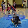 Children play carnival games Saturday during a free carnival hosted by Girl Scout Troop 1058 at First Lutheran Church in DeKalb. In lieu of an entrance fee, the troop collected fleece clothing items, fleece blankets, rain coats, rain boots and Croc-style shoes to help rural villagers in Madagascar.