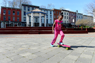Tania Barricklo-Daily Freeman                      Kamiyah Hendricks, 6 1/2, daughter of Latasha Thomas of Kingston, practices her skateboarding skills after school Monday at Gallo Park in the Rondout.