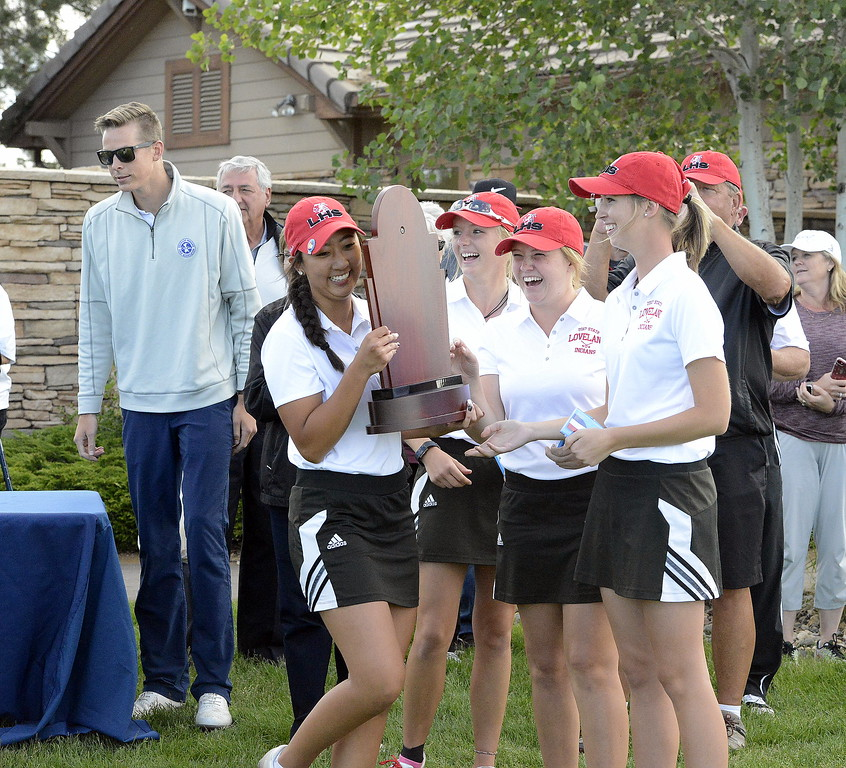 Loveland's golf team is all smiles as they collect their first-place trophy after winning the 4A title Tuesday at Colorado National Golf Club in Erie. The Indians' two-day total of 475 was 27 strokes clear of runner-up Windsor.