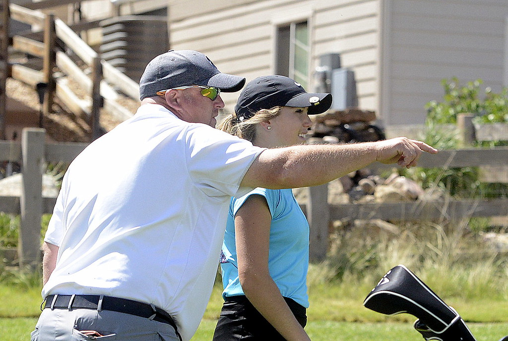 . Mountain View\'s Renee Demaree and coach Dave Hunn discuss a shot during Monday\'s first round of the 4A state golf tournament at Colorado National Golf Club in Erie.