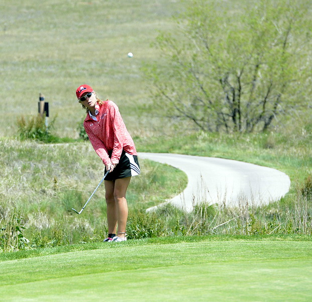 Loveland's Lauren Lehigh chips onto the green during the second round of the 4A State Girls Golf Tournament on Tuesday at Colorado National Golf Club in Erie.