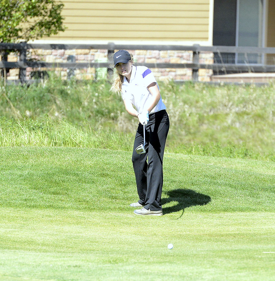 Renee Demaree of Mountain View putts onto the green during the second round of the 4A State Girls Golf Tournament on Tuesday at Colorado National Golf Club in Erie.
