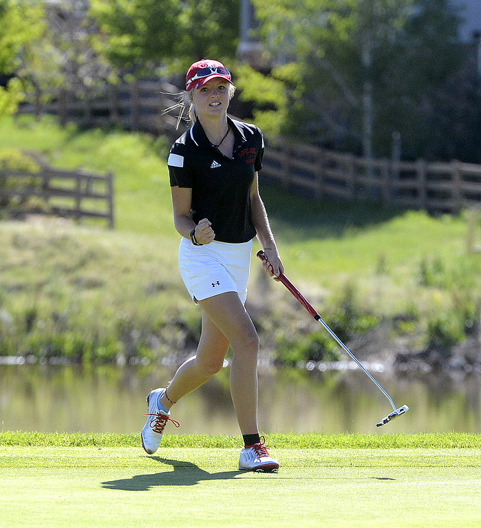 . Lauren Lehigh gives a fist pump after sinking a birdie putt on the second hold of Monday\'s first round of the 4A state golf tournament at Colorado National Golf Club in Erie. The Loveland sophomore shot 1-over par to take a two-stroke lead.