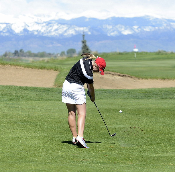 Aili Bundy hits off the fairway during the opening round of the 4A state golf tournament Monday at Colorado National Golf Club in Erie. The senior shot a 78 to put her fifth.