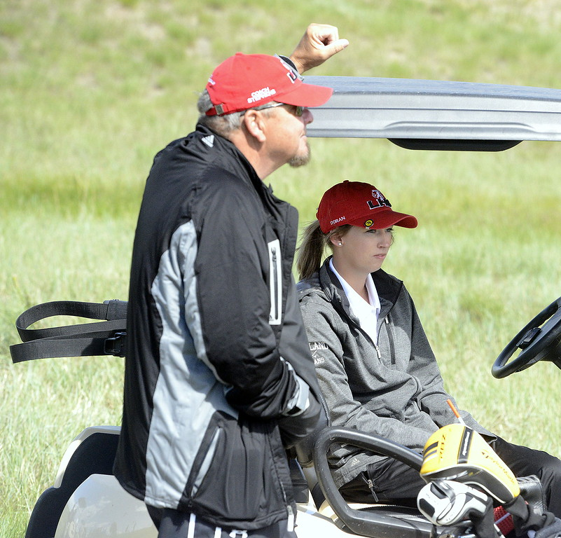 Loveland's Hannah Doran sits in coach Bill Stephens' golf cart prior to the start of the second round of the 4A State Girls Golf Tournament on Tuesday at Colorado National Golf Club in Erie.