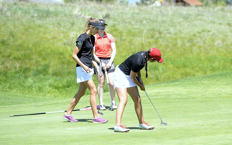Loveland's Natalee Hall watches her putt drop during Monday's first round of the 4A state golf tournament at Colorado National Golf Club in Erie.