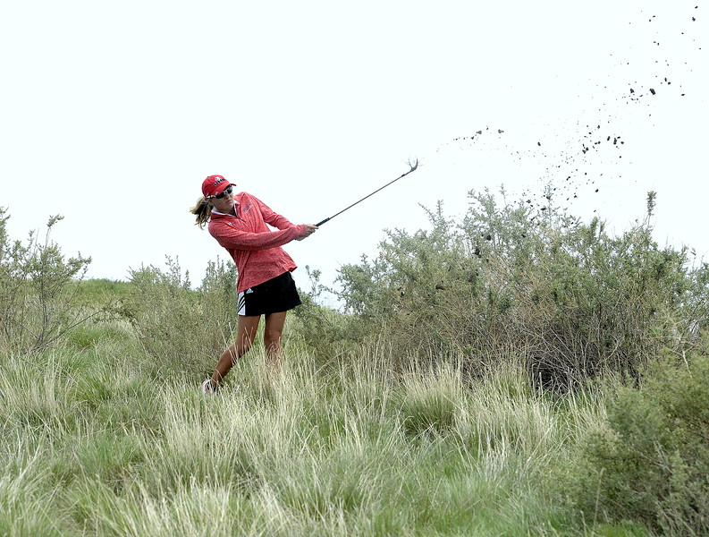 Loveland's Lauren Lehigh hits out of the high grass after a wayward iron off the fairway on the 13th hole during the second round of the 4A State Girls Golf Tournament on Tuesday at Colorado National Golf Club in Erie. The sophomore won the state title with a two-day total of 152, becoming the school's second indivudal champion and leading the program to it's first team title.