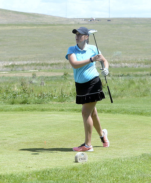 Mountain View's Katie Haag watches her tee shot during Monday's first round of the 4A state golf tournament. She carded a 97 in her first state action.