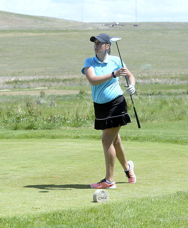 . Mountain View\'s Katie Haag watches her tee shot during Monday\'s first round of the 4A state golf tournament. She carded a 97 in her first state action.