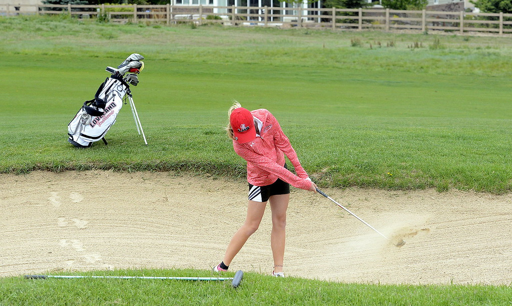 . Loveland\'s Lauren Lehigh hits out of the sand during the second round of the 4A State Girls Golf Tournament on Tuesday at Colorado National Golf Club in Erie.