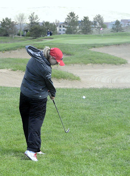 Loveland's Hannah Doran hits an iron to the green during the second round of the 4A State Girls Golf Tournament on Tuesday at Colorado National Golf Club in Erie.