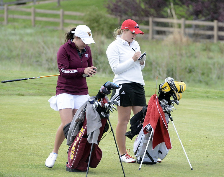 Loveland's Aili Bundy (right) writes in her notebook during the second round of the 4A State Girls Golf Tournament on Tuesday at Colorado National Golf Club in Erie. The senior had the best round of the final day to finished tied for second with a two-day total of 153.